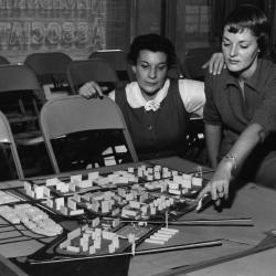 Ms Matilda Stein (left) and Ms. Phyllis Quackenbush, secretaries of the Lower East Side Neighborhood Association study a model of a project by Cooper Union architecture students.