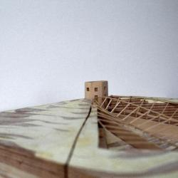 Model, view facing northwest Genealogy Tower: Site depression with bridges and roofs.