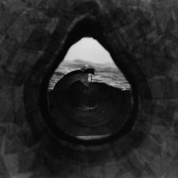 Model,view to ocean through knot hole in tree.