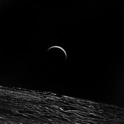 Earth over lunar horizon.